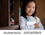 cute girl smile standing and... | Shutterstock . vector #1092605855