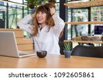 young business woman sitting at ... | Shutterstock . vector #1092605861