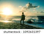 walk of a woman on the island... | Shutterstock . vector #1092631397
