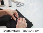 tailor's business. the hem of... | Shutterstock . vector #1092643124