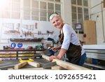 senior woman doing woodwork in... | Shutterstock . vector #1092655421