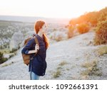 a woman is traveling with a... | Shutterstock . vector #1092661391
