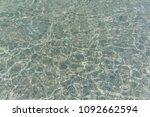 shimmering sun glares on pebble ... | Shutterstock . vector #1092662594