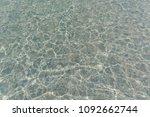 shimmering sun glares on pebble ... | Shutterstock . vector #1092662744