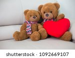 teddy bear sitting on the sofa. | Shutterstock . vector #1092669107