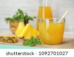 glass with delicious pineapple... | Shutterstock . vector #1092701027