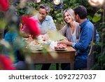 a summer evening of friends in...   Shutterstock . vector #1092727037