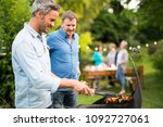 n a summer evening   two men ... | Shutterstock . vector #1092727061