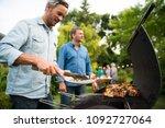 n a summer evening   two men ...   Shutterstock . vector #1092727064