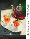 glass of black tea in double... | Shutterstock . vector #1092746471