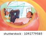 cute asian child having fun at... | Shutterstock . vector #1092779585