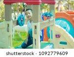 cute asian child having fun at... | Shutterstock . vector #1092779609