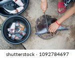 hands of women cutting fish for ... | Shutterstock . vector #1092784697