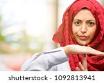 young arab woman wearing hijab... | Shutterstock . vector #1092813941