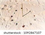 Sundial On The Beach Made Of A...
