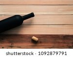 black bottle of red wine on a... | Shutterstock . vector #1092879791