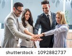 business team showing unity... | Shutterstock . vector #1092882737