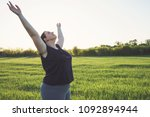 Small photo of Body positive, freedom, high self esteem, confidence, happiness, success, positive affirmation, inspiration, meditation Overweight woman practicing yoga on meadow