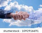partnership handshake of a... | Shutterstock . vector #1092916691