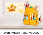 yellow school bag on wooden... | Shutterstock . vector #1092929039