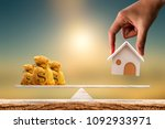woman hand hold a wooden home... | Shutterstock . vector #1092933971
