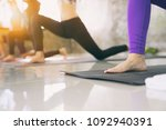 women exercising in fitness... | Shutterstock . vector #1092940391