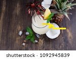 pina colada cocktail and... | Shutterstock . vector #1092945839