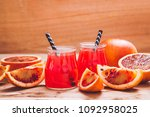 blood orange juice. red orange...   Shutterstock . vector #1092958025