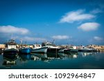 fishing boats anchored in the... | Shutterstock . vector #1092964847