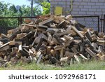 a pile of dry chopped firewood. ... | Shutterstock . vector #1092968171