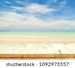 wooden floor and sea landscape... | Shutterstock . vector #1092975557