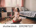 child girl cleaning her messy... | Shutterstock . vector #1092987227
