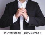 businessman cracking fingers. | Shutterstock . vector #1092989654