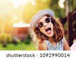 summer portrait of happy kid... | Shutterstock . vector #1092990014