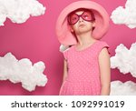 fashionable girl posing on a... | Shutterstock . vector #1092991019