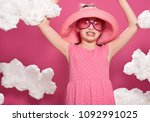 fashionable girl posing on a... | Shutterstock . vector #1092991025