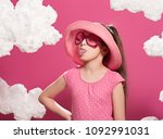 fashionable girl posing on a... | Shutterstock . vector #1092991031