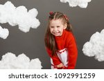 girl playing with clouds ... | Shutterstock . vector #1092991259