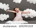girl playing with clouds  shot... | Shutterstock . vector #1092991529