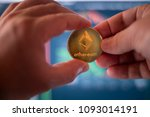 Small photo of Ethereum Ether ETH Crypto Currency Token Altcoin Digital Money Two Person Financial Transaction Concept