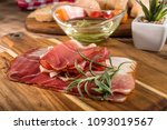 thinly sliced german black... | Shutterstock . vector #1093019567