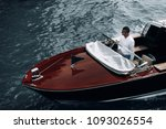 young guy on a yacht | Shutterstock . vector #1093026554