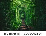 a railway in the spring forest... | Shutterstock . vector #1093042589