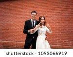 gorgeous happy wedding couple... | Shutterstock . vector #1093066919