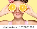 young happy girl posing with... | Shutterstock . vector #1093081235
