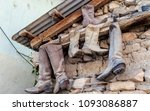 old dusty cowboy boots from... | Shutterstock . vector #1093086887