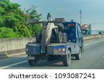editorial use only  a tow truck ... | Shutterstock . vector #1093087241
