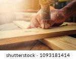 close up carpenter using hammer ... | Shutterstock . vector #1093181414