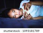 Teen girl lying in bed at night ...