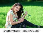 beautiful girl sitting on a... | Shutterstock . vector #1093227689